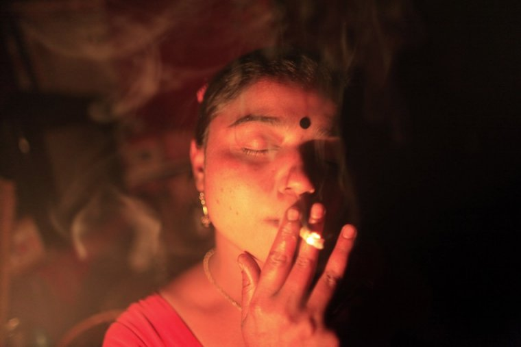 seventeen-year-old-hashi-smokes-cigarette-inside-her-room-before-she-serves-customer-kandapara