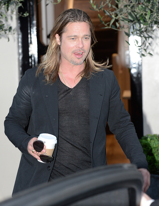 Brad Pitt, holding a cup of coffee, leaves a private residence to go see Muse perform at Horse Guards Parade Ground in St. James' Park
