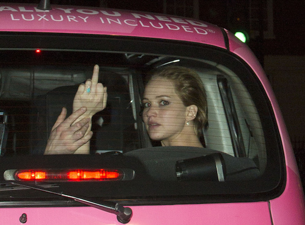 Jennifer Lawrence Flicks The Bird With 'Love Is All You Need' Printed Above Her Head Riding A Pink Taxi With Nicholas Hoult