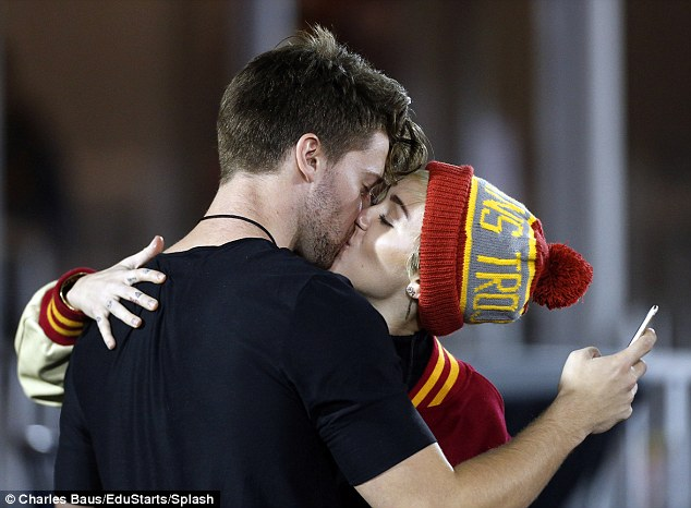 1415950419711_Image_galleryImage_Miley_Cyrus_and_Patrick_S