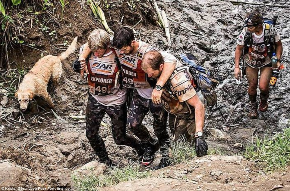 All terrains: Despite numerous attempts by the team to get rid of the dog, primarily for his own safety, he refused to go. It meant when he got stuck in the knee-deep mud they helped get him out and when he was exhausted, they stopped to take a break