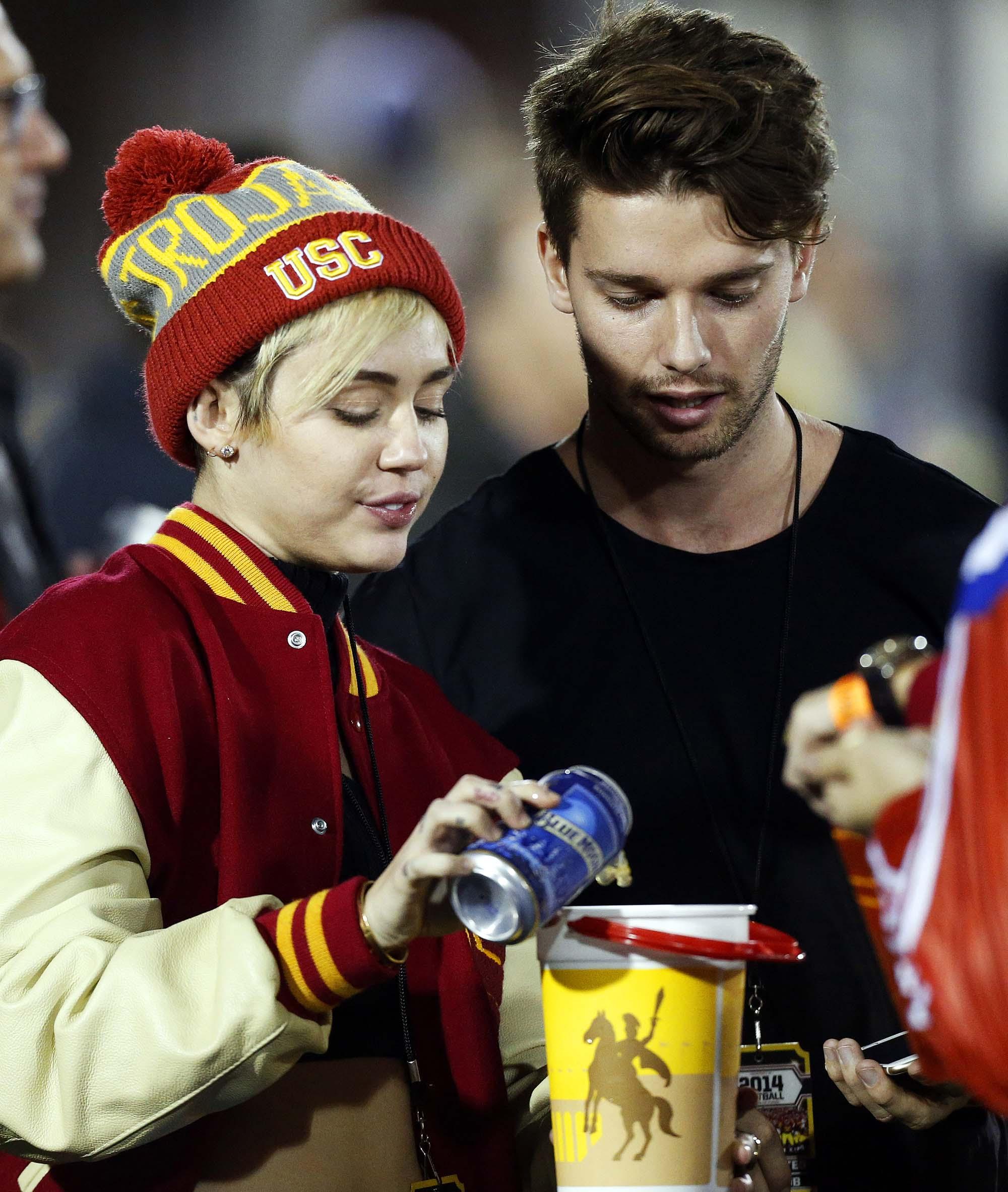 Patrick Schwarzenegger, and Miley Cyrus sighting at USC football game