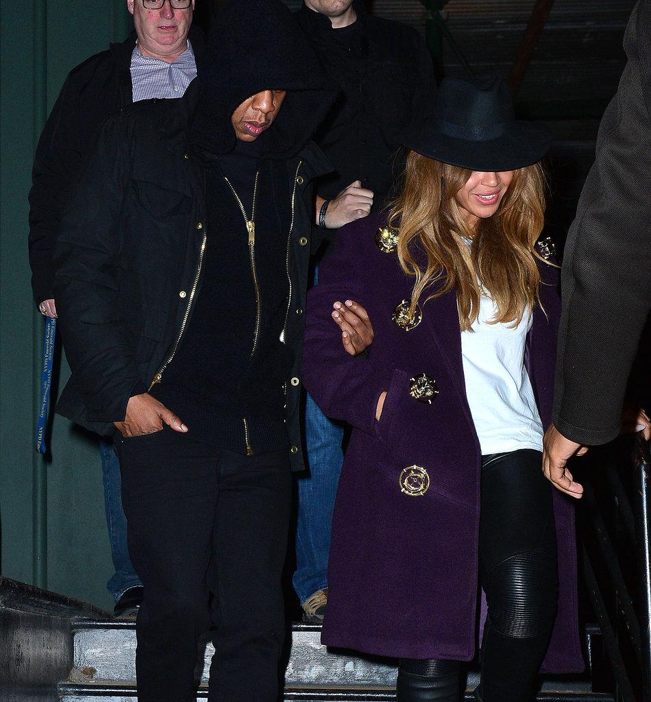 Jay-Z-held-Beyoncés-arm-left-Taylor-building