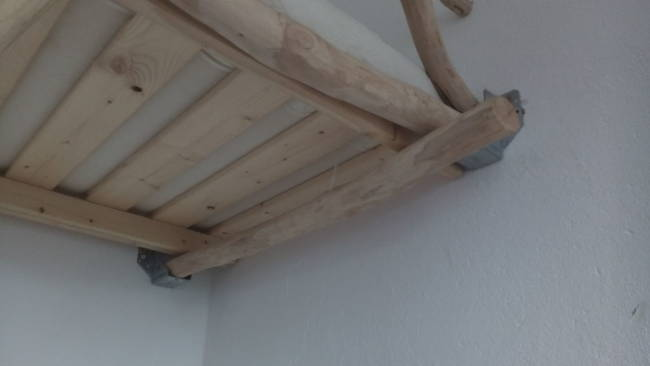 Metal braces were also used to hold the bed frame in place against the walls.