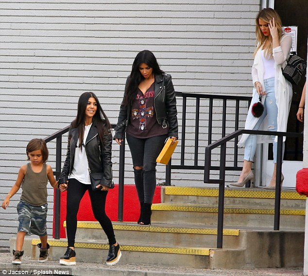 2A29025300000578-3146753-All_together_The_sisters_apart_from_Kendall_were_seen_exiting_a_-m-153_1435808876390
