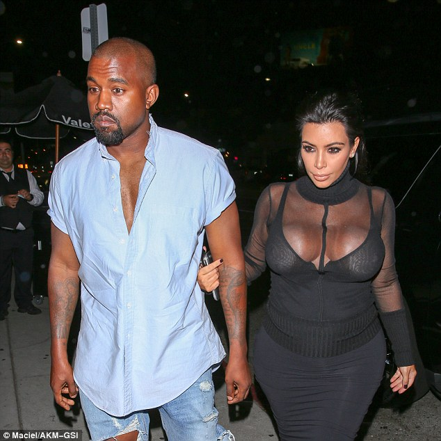 2B3C9B6F00000578-3191942-Be_careful_Kim_held_on_tight_to_husband_Kanye_as_she_teetered_in-a-73_1439190592652