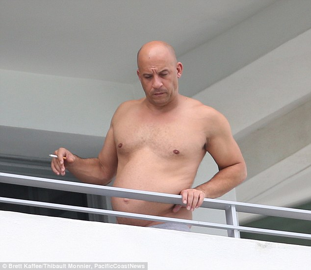 2D25D7D600000578-3262544-Enjoying_a_cheeky_smoke_Vin_Diesel_took_his_shirt_off_while_bask-m-85_1444167178728