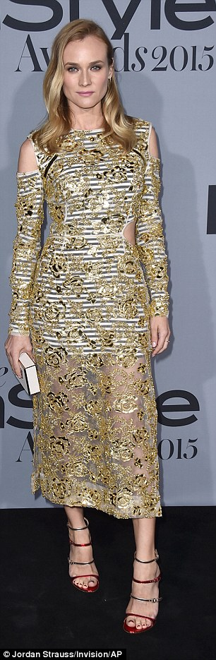2DD29D5500000578-3291041-Always_perfect_Diane_Kruger_39_glittered_in_a_golden_midi_dress_-a-135_1445915762005