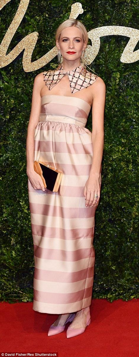 2EBD787700000578-3330941-Poppy_Delevingne_s_striped_dress_by_Emilia_Wickstead_was_cute_en-a-15_1448353596984