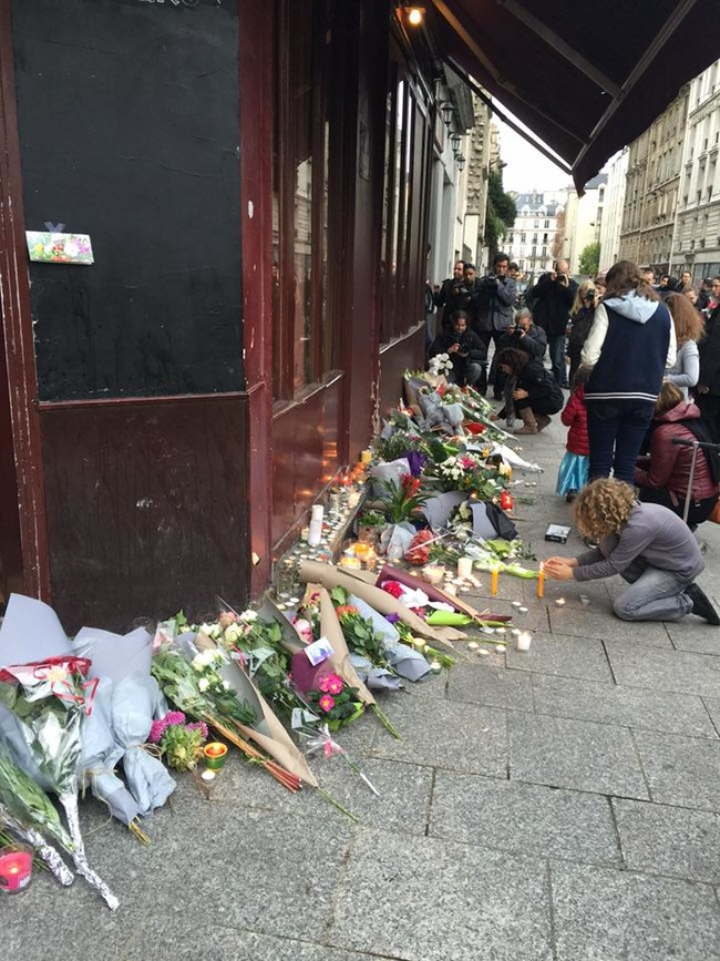 """""""The area had been cleaned but bullet holes were evident everywhere. Crowds were growing as the sun set. When I was there, the crowd was absolutely silent."""""""