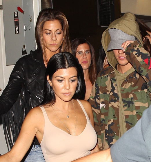 Kourtney Kardashian and Justin Bieber looking happy walking out of The Good Guy together