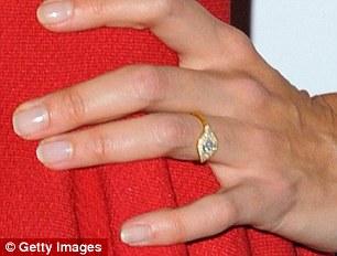 2FD8EDEC00000578-3390801-Pretty_The_diamond_is_set_in_yellow_gold-m-113_1452279008562