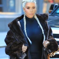 Kim Kardashian wears sports tights under fur coat with braided blonde hair in NYC