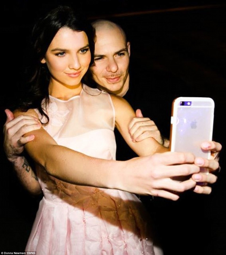 3207594500000578-3483958-Stunning_Maya_pictured_above_with_Pitbull_wore_a_bespoke_dress_b-a-10_1457538440366