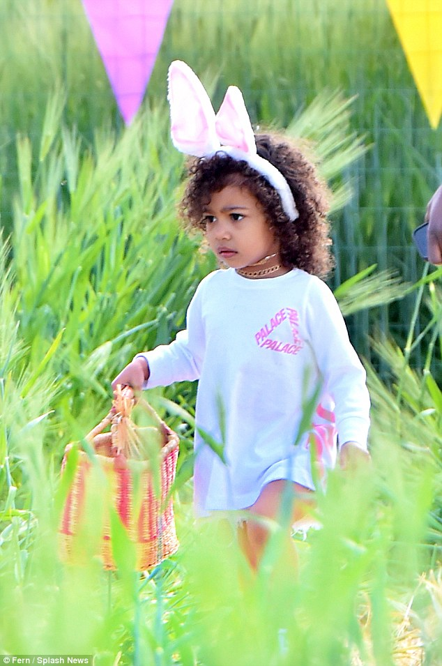 327ED5D100000578-3505467-This_way_North_North_fills_her_cousin_s_Easter_basket_as_the_BFF-a-51_1458762890571