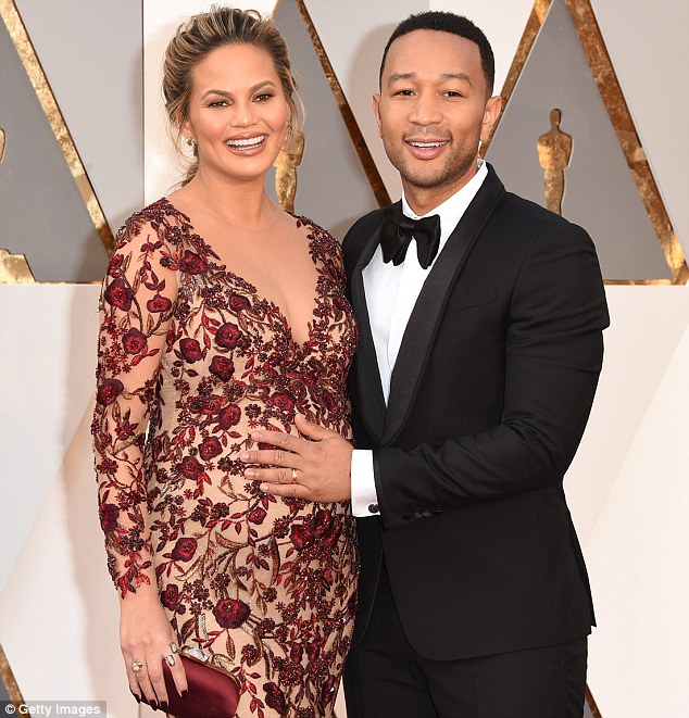 3346061300000578-3544475-_She_s_here_Chrissy_Teigen_and_John_Legend_pictured_in_February_-m-13_1460905200780