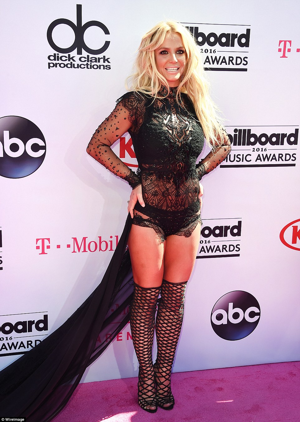 3481EA6B00000578-3604063-Demanded_attention_On_the_red_carpet_Britney_was_very_close_to_n-a-53_1463989034198