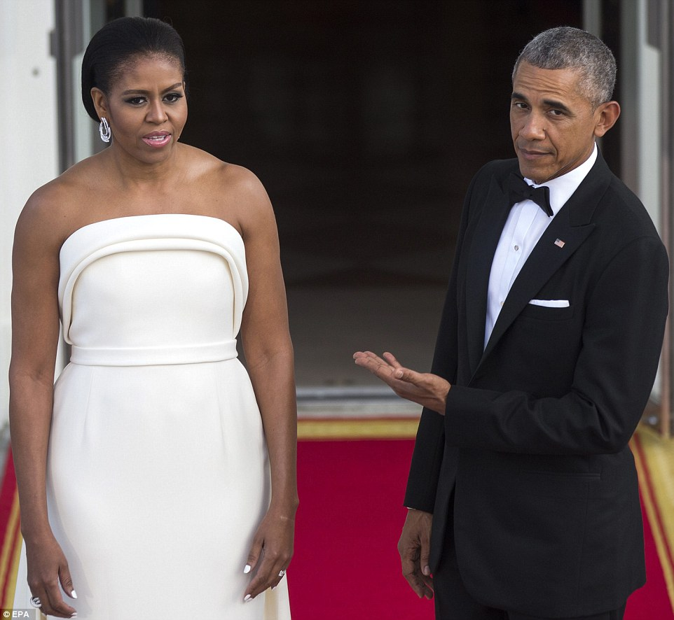 36D18CAA00000578-3720584-President_Barack_Obama_and_First_Lady_Michelle_Obama_await_the_a-a-32_1470187166303