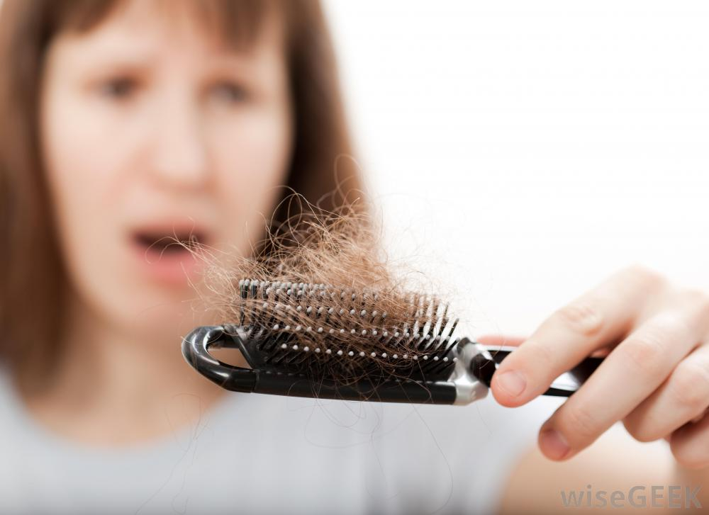woman-with-hair-loss-looking-at-brush