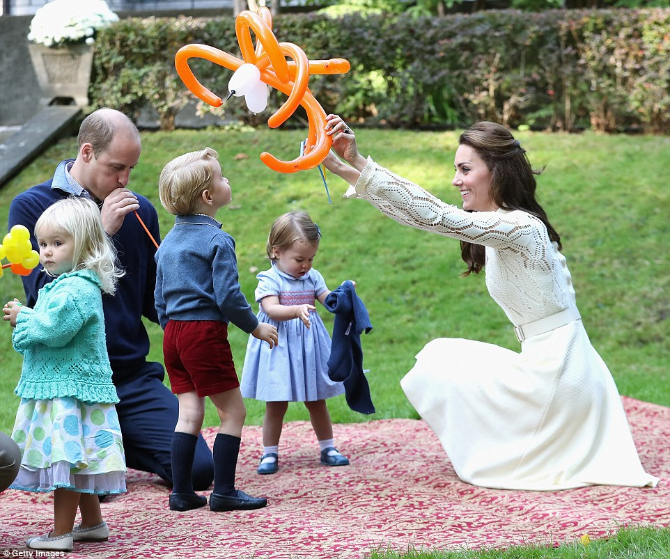 38EEC99300000578-3814262-The_Duchess_of_Cambridge_lifts_his_ball-m-44_1475188277923