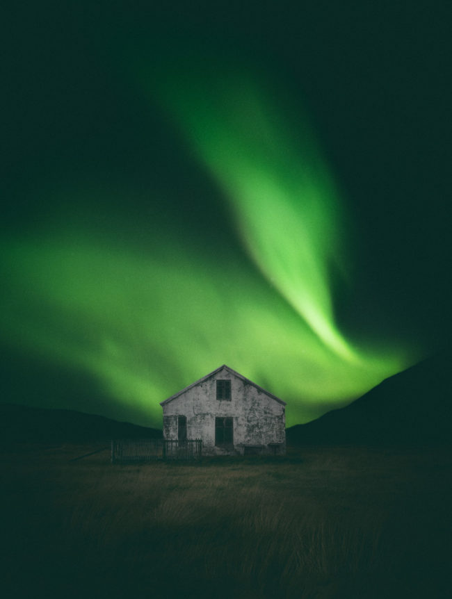 Northern Lights dancing above an abandoned farmhouse | Westfjords